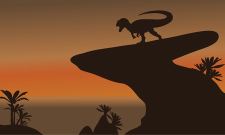 behemoth: Silhouette of one allosaurus in cliff at the afternoon