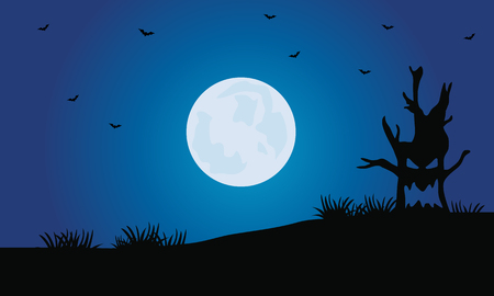 Silhouette of tree monster and full moon Halloween scenery