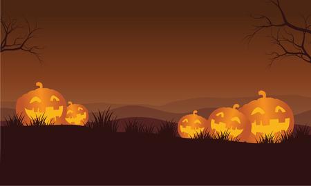 macabre: Silhouette of Halloween orange pumpkins in hills vector Illustration