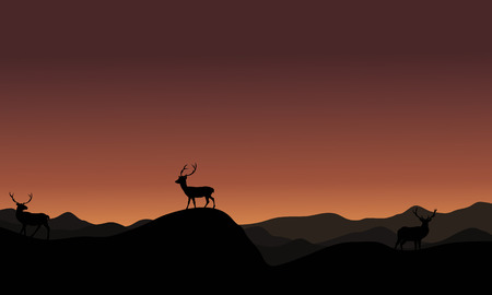 silhoutte: At sunset antelope landscape silhoutte on brown backgrounds