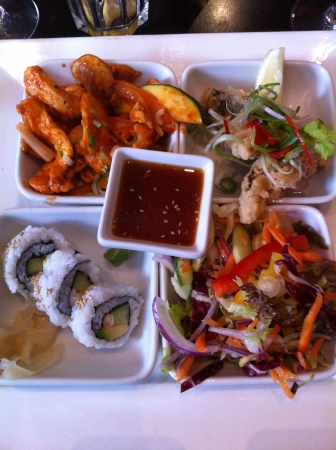 bento box: Japanese bento box with a selection of sushi chicken fish and salad