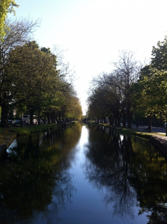 Symmetrical reflection of the Grand Canal Dublin. Taken on a bridge over the canal
