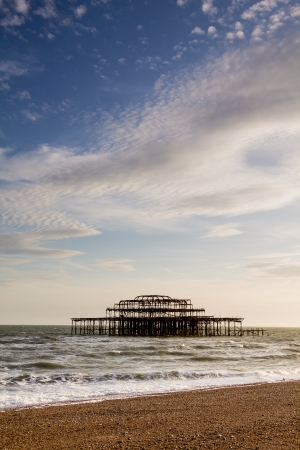 Portrait shot of the ruined West Pier in Brighton, England