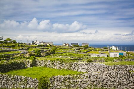 Houses and Stone Walls on the Aran Island of Inisheer, County Galway, in the West of Ireland Stock Photo - 133407060