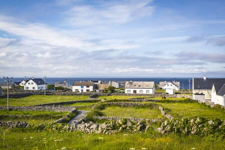 Houses and Stone Walls on the Aran Island of Inisheer, County Galway, in the West of Ireland Stock Photo - 133407061