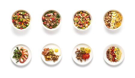 Top view of different salads on white background