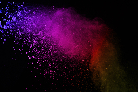 Explosion of colored powder on black background. Colorful of dust explode.