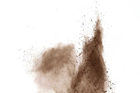 Coffee explosion isolated on white background.Explosion of brown powder, isolated on white background. Stock Photo