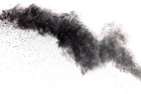 Black powder explosion. Closeup of black dust particles explode isolated on white background.