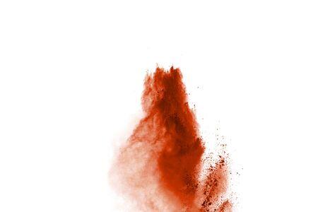 orange powder explosion isolated on white background.
