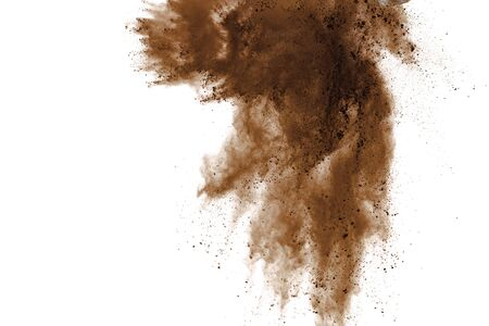 Explosion of brown powder on black background.