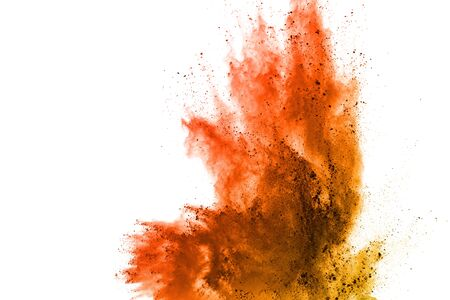 Launched orange powder on white background. Banque d'images