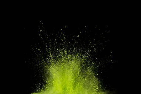 green powder explosion isolated on Black background.Colored dust splash isolated. Banque d'images