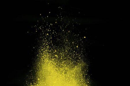 Gold powder explosion isolated on Black background.