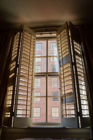 window shade: Old Style Windows Facing Others Stock Photo