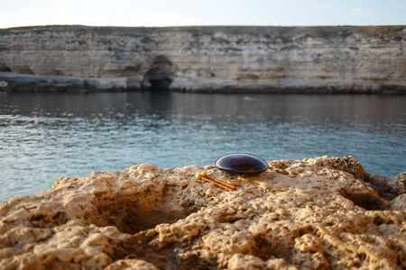 Musical instrument glucophone on a rocky seashore. Imagens