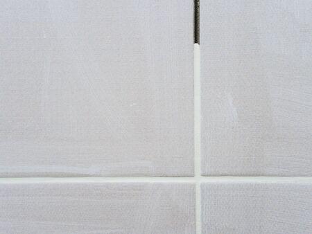 Repair in the bathroom. Grouting between tiles.