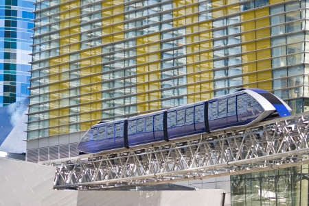 A monorail train passes beside the multi-colored facade of the modern CityCenter complex in Las Vegas, Nevada Stock Photo - 14816199