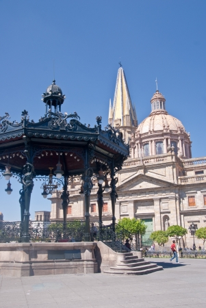 An ornate wrought iron bandstand is the focal point for public gatherings in the main downtown square, beside the historic cathedral in Guadalajara Mexico