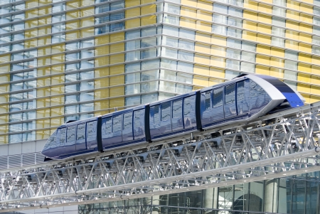 A monorail train passes beside the multi-colored facade of the modern CityCenter complex in Las Vegas, Nevada