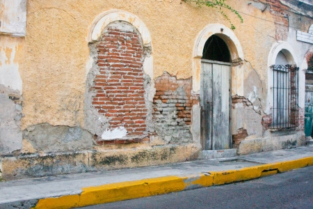 Rustic and weathered exterior of old colonial building incentral Mazatlan Mexico