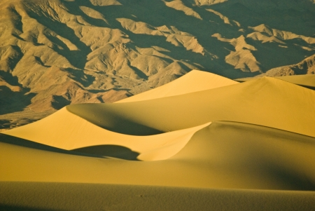 Wind sculpted dunes at Death Valley National Park in California at sunset