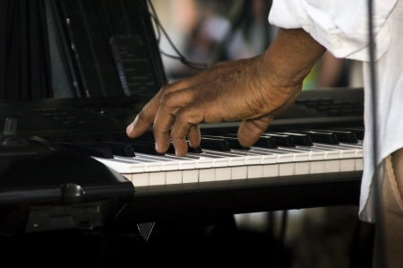 ivories: A musician tickles the ivories on an electronic keyboard