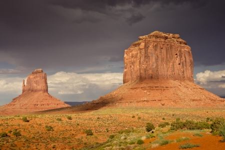Majestic sandstone monoliths in evening light after thunderstorms at Monument Valley