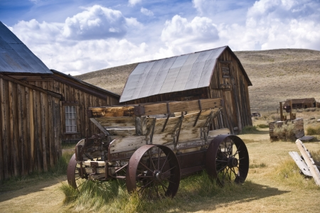Weathered rustic wagon and barn at an old west ghost town
