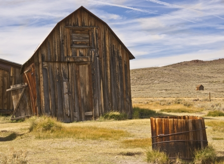 Weathered rustic barn and outbuildings at an old west ghost town Stock Photo
