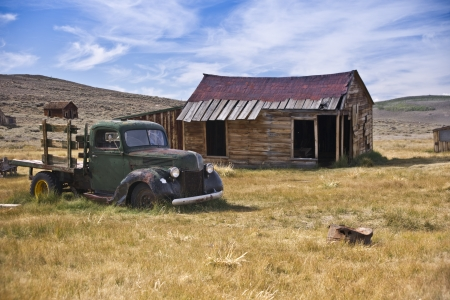 An old vintage truck rests where it died in a California goldrush ghost town