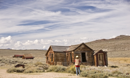 A woman photographer shoots the ruins of an old California ghost town Stock Photo