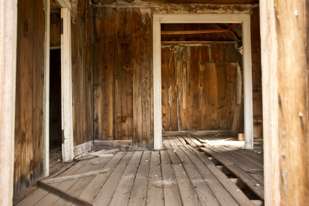 A dilapidated building interior in a derelict building in a western ghost town  photo