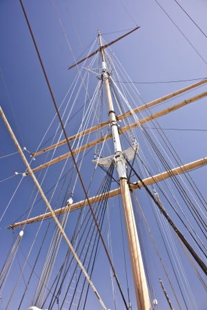 Masts soar above an historic windjammer sailing ship berthed in San Francisco harbor photo