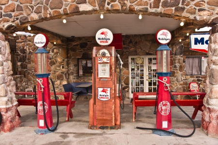 Cool Springs, AZ, USA - December 30, 2012: Old time gas pumps outside a restored service station on old Route 66 in Arizona are reminders of the early days of American auto travel. Photo taken Dec. 30, 2012.