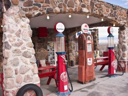Cool Springs, AZ, USA - December 30, 2012: Old time gas pumps outside a restored service station on old Route 66 in Arizona are reminders of the early days of American auto travel. Photo taken Dec. 30, 2012. Stock Photo - 17356035