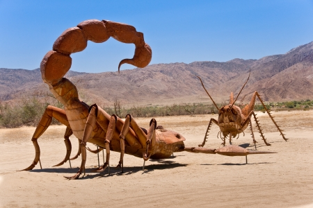 Borrego Springs, California - June 25, 2012  A giant Scorpion and Grasshopper join the sculpture collection of prehistoric animals on permanent display at Galetta Meadows