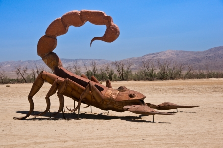 the fittest: Borrego Springs, California - June 25, 2012 Artist Ricardo A  Breceda has added a Scorpion vs  Grasshopper sculpture to the collection of prehistoric animals on permanent display at Galetta Meadows
