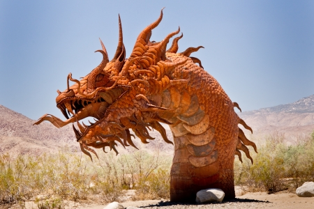Borrego Springs, California - June 25, 2012  A 350-foot long Serpent sculpture roars above the desert at the collection of prehistoric animals on permanent display at Galetta Meadows
