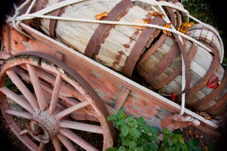 kegs: Old wooden kegs sit in an old woodnen wagon
