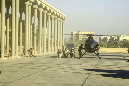 maching: Operators from Blackwater USA provide security for diplomatic missions and  congressional delegations visiting Baghdad Iraq as a helicopter stands by for quick reaction extraction in December 2006