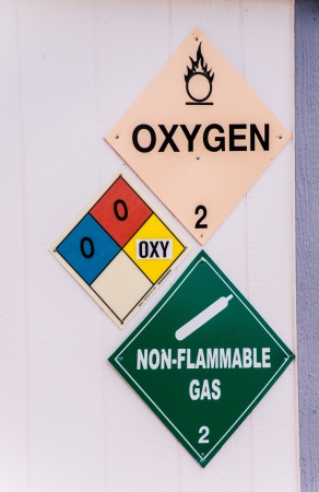 Warning signs alert workers to the presence of oxidizing chemicals in the workplace