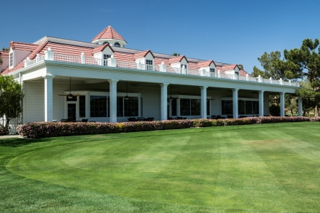 Primm, Nevada, USA - April 25, 2013 A stately golf course clubhouse and lush lawn welcomes tournament players to Primm Valley in Primm Nevada