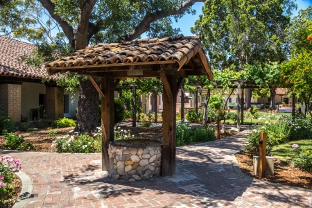An old water well at the historic mission in San Luis Obispo, California  Stock Photo