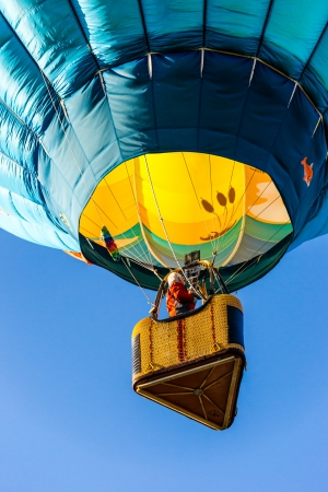ascends: A colorful hot air ballon ascends into the sky at daybreak