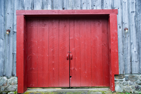Red door on a rustix wooden barn in New Hampshire.