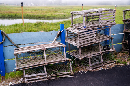 traps: Old fashioned wooden lobster traps sit idle at a new England harbor.
