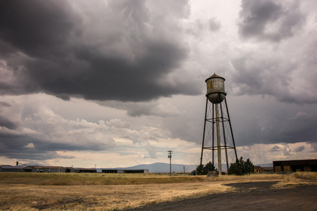 rural town: An abandoned water tower rusts away at a depressed rural town.
