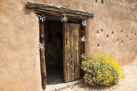 southwestern: Whimsicl entry to a southwestern adobe building Stock Photo