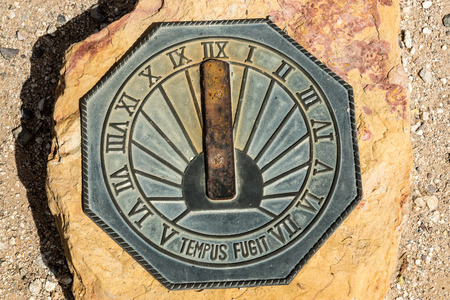 sundial: An old fashioned sundial set in stone Stock Photo